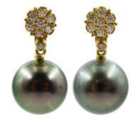 Pair of 18ct gold diamond flower head cluster stud earrings