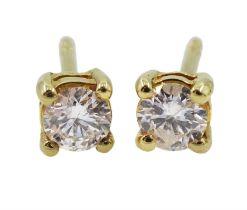 Pair of 18ct gold single stone round brilliant cut diamond stud earrings