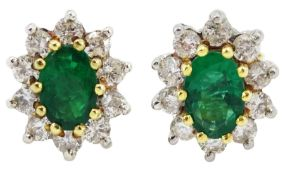 Pair of 18ct gold oval emerald and round brilliant cut diamond cluster stud earrings