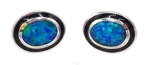 Pair of silver oval opal stud earrings
