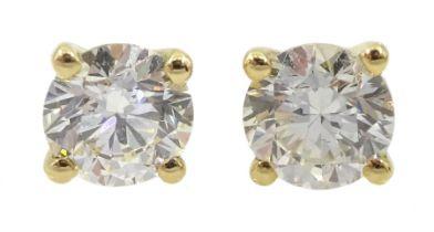 Pair of single stone round brilliant cut diamond stud earrings