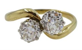 Early 20th century 18ct gold and platinum two stone old cut diamond crossover ring