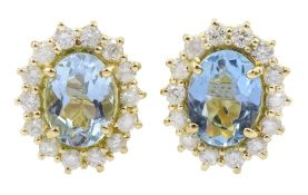 Pair of 18ct gold oval aquamarine and diamond cluster stud earrings