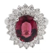 White gold oval tourmaline and round brilliant cut diamond cluster ring