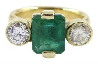 18ct gold three stone emerald and round brilliant cut diamond ring