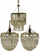 Mid 20th century cut glass centre light fitting and a pair of brass and glass light fittings (3)