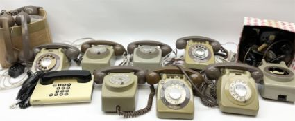 Collection of vintage telephones and spare parts including handsets.