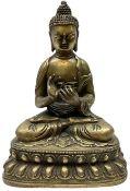 Cast brass figure of a seated Buddha