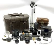 Ensign Focal Plane Roll Film Reflex camera in a brown leather carrying case with purple lining