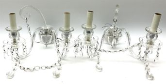 Pair of glass wall sconces