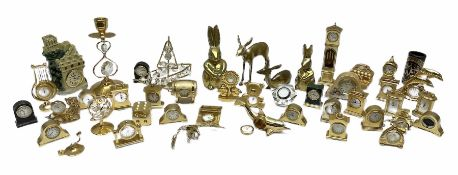 Collection of brass miniature clocks to include examples modelled as mantel clocks