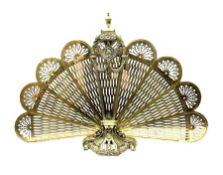 Brass peacock fire screen