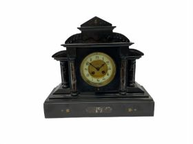 19th century Belgium slate mantle clock with an eight-day French rack striking movement striking the