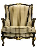 Thomas Messel design classical ebonised and gilded wing back chair