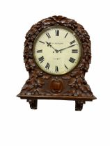 A mid-19th century eight-day Oak cased twin Fusee wall clock with integral support bracket