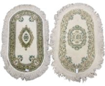 Two oval Indian woollen rugs