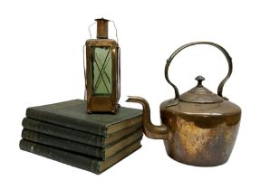 Copper and glass lantern together with a copper kettle and four volumes of the horse its' treatment