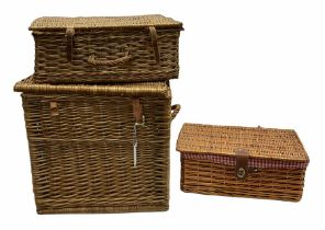 Two wicker picnic baskets with hinged lids