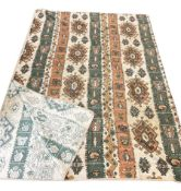 Large throw decorated with kilim type design