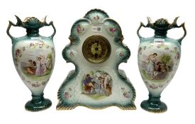 Three piece ceramic clock garniture