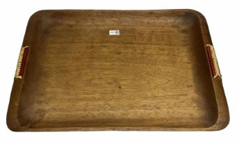 Wooden tray with plaited handles