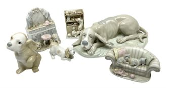 Nao figure of a recumbent dog and a quantity other ceramic dog figures