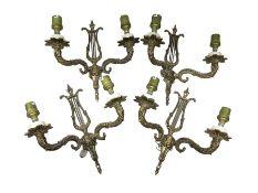 Set of four gilt metal wall sconces