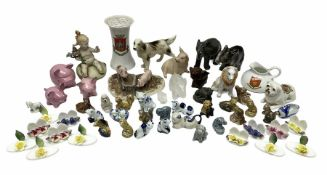 Quantity of ceramic figures of animals to include a crested ware model of a recumbent pug