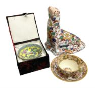 Oriental ceramics comprising a figure of a sea lion decorated with floral pattern with character mar