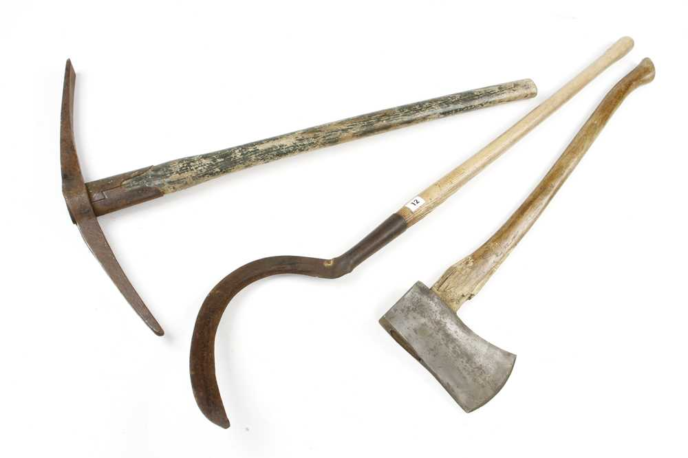 A slasher and an axe by ELWELL and a pick axe by BRADES G