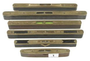 Six brass topped levels G