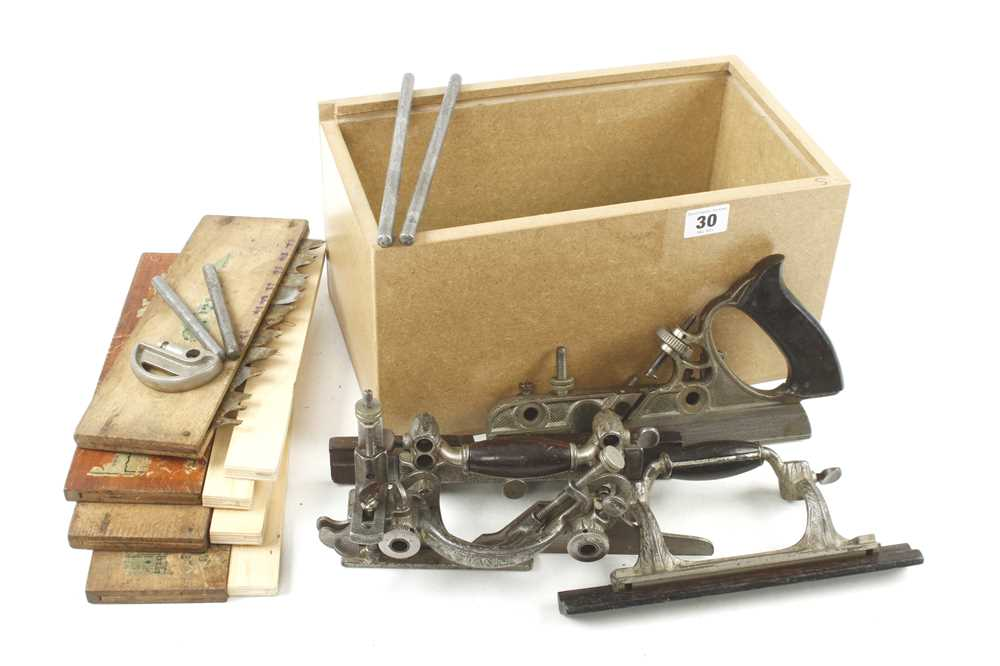 A STANLEY No 55 combination plane with 4 boxes of cutters G+