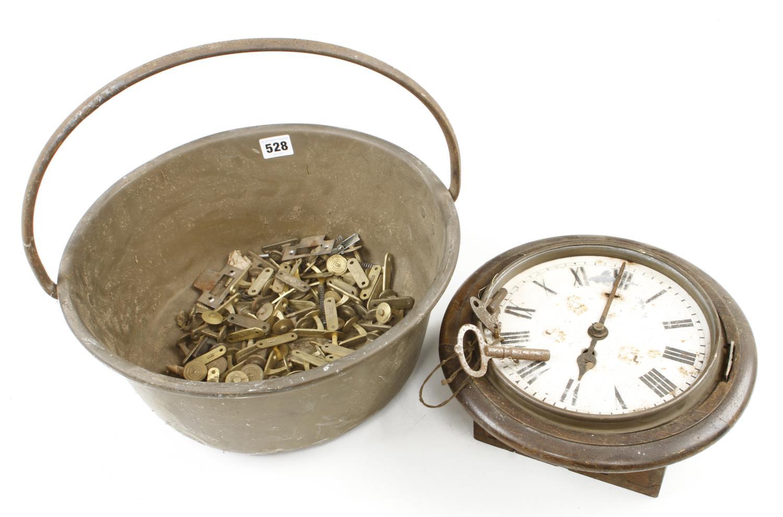 A brass jam pan and an old clock G-