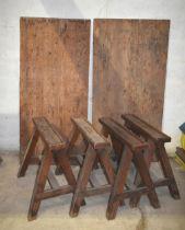 Four upholsterer's wooden trestles c/w two tops