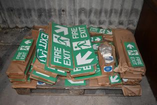 A quantity of Fire Exit and other signs