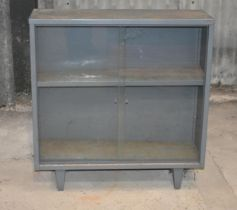 A glass front metal cupboard