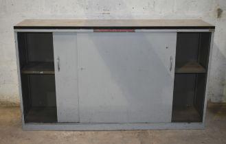 A metal cupboard with sliding doors