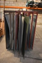 A large sheet metal rack containing a quantity of galvanised and sheet steel