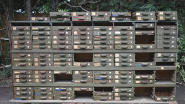 """A vintage multi-drawer partners or double sided chest of drawers 9'6"""" x 2'4"""" wide ex De Havilland"""