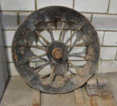 A heavy vintage spoked lift shaft wheel