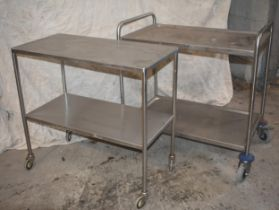 Two stainless steel trolleys