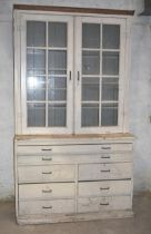 A large pine glazed bookcase/plan chest