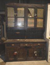 A large antique pine dresser with glazed doors for restoration