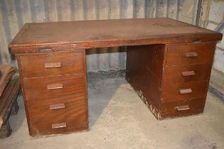A vintage pedestal office desk