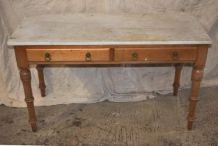 A pine table with marble top