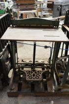 A vintage printer's letterpress perforating machine and a punching machine