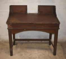 A clerk's antique desk with woodgrain finish