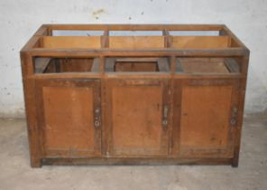 A workbench with cupboards beneath