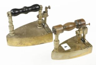 Two brass smoothing irons both with slugs G+