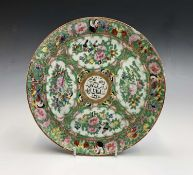 A Chinese Canton porcelain plate, 19th century, for the Islamic market, the central medallion filled